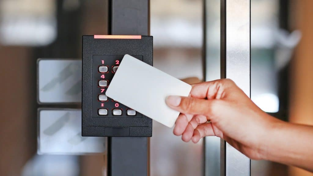 person holding proximity card to reader